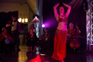 Greenstone Belly Dance Director, Siobhan, performing Middle Eastern dance to live music with Dunedin-based band, the Unfortunate Repercussions.