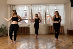 Greenstone Belly Dance Improver students running through a choreography by Siobhan before the student show in Montreal, Quebec.